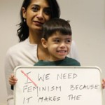 woman and boy with feminism sign